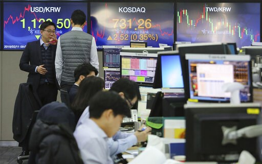 (AP Photo/Ahn Young-joon). Currency traders work at the foreign exchange dealing room of the KEB Hana Bank headquarters in Seoul, South Korea, Monday, Feb. 11, 2019. Asian stocks were mixed on Monday as traders watched for developments on a fresh round...