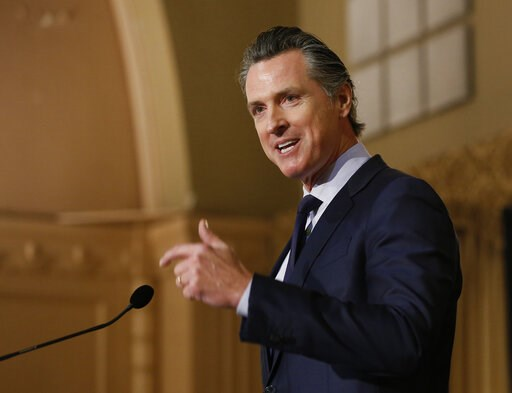 (AP Photo/Rich Pedroncelli, File). FILE - In this Jan. 17, 2019 file photo, Gov. Gavin Newsom speaks at the California Legislative Black Caucus Martin Luther King Jr., Breakfast, in Sacramento, Calif. Newsom is withdrawing several hundred National Guar...