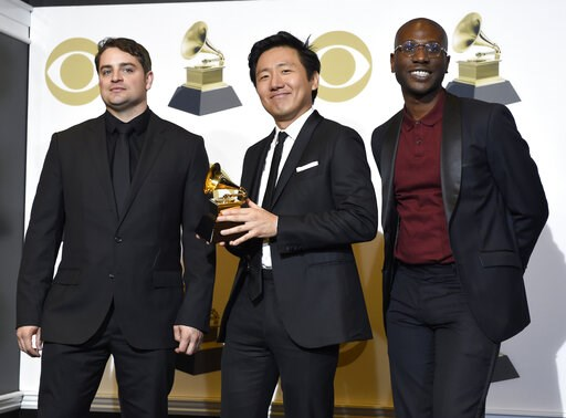 "(Photo by Chris Pizzello/Invision/AP). Jason Cole, from left, Hiro Murai and Ibra Ake pose in the press room with the award for best music video for Childish Gambino's ""This Is America"" at the 61st annual Grammy Awards at the Staples Center on Sunday, ..."