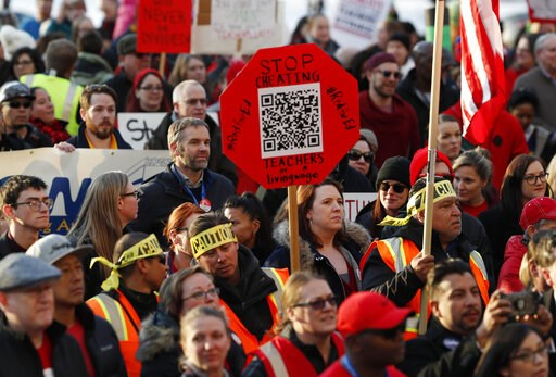 (AP Photo/David Zalubowski, File). FILE - In this Jan. 30, 2019, file photo, Denver Public Schools teachers rally outside the State Capitol in Denver. Denver teachers are planning to strike Monday, Feb. 11, 2019 after failed negotiations with the schoo...