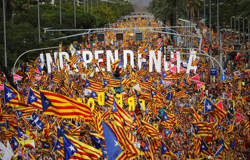 (AP Photo/Emilio Morenatti, File). FILE - In this Tuesday, Sept. 11, 2018 file photo, pro-Independence demonstrators gather at La Diagonal, one Barcelona's main avenues, during the Catalan National Day in Barcelona, Spain. Spain's Supreme Court is brac...