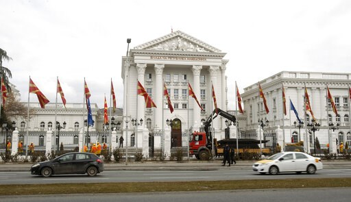 (AP Photo/Boris Grdanoski). Workers dismantle metal fencing from the front of the Macedonia's Government in the capital Skopje, Thursday, Feb. 7, 2019. Dozens of workers have started dismantling the metal fence around the Macedonian government building...