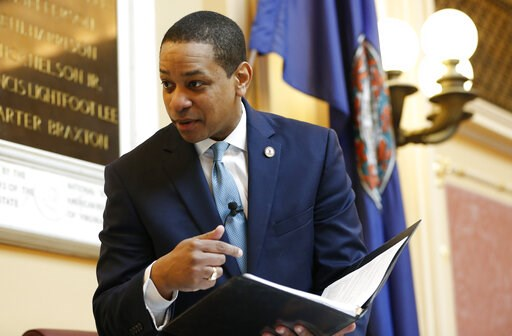 (AP Photo/Steve Helber). Virginia Lt. Gov Justin Fairfax looks over a briefing book prior to the start of the senate session at the Capitol in Richmond, Va., Thursday, Feb. 7, 2019. A California woman has accused Fairfax of sexually assaulting her 15 y...