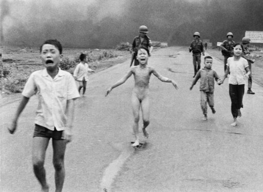 (AP Photo/Nick Ut, File). FILE - In this June 8, 1972 file photo, South Vietnamese forces follow after terrified children, including 9-year-old Kim Phuc, center, as they run down Route 1 near Trang Bang after an aerial napalm attack on suspected Viet C...