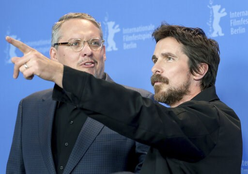 (AP Photo/Michael Sohn). Director Adam McKay, left, and actor Christian Bale pose for the photographers during a photo call for the film 'Vice' at the 2019 Berlinale Film Festival in Berlin, Germany, Monday, Feb. 11, 2019.