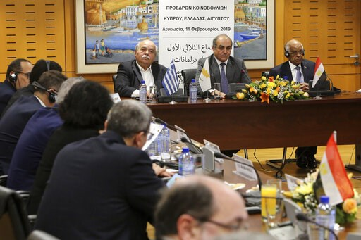 (AP Photo/Petros Karadjias). Cypriot Parliamentary Speaker Demetris Syllouris, center, with counterparts Ali Abdel-Aal of Egypt, right, and Nikos Voutsis of Greece, left, talk during a press conference i the parliament house in capital Nicosia, Cyprus,...