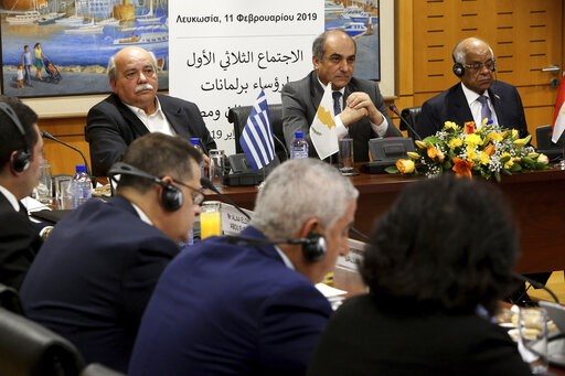 (AP Photo/Petros Karadjias). Cypriot Parliamentary Speaker Demetris Syllouris, center, with his counterparts Ali Abdel-Aal of Egypt, right, and Nikos Voutsis of Greece, left, talk during a press conference in the parliament house in capital Nicosia, Cy...
