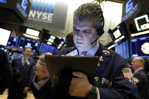 (AP Photo/Richard Drew, File). FILE- In this Feb. 5, 2019, file photo trader John Panin works on the floor of the New York Stock Exchange. The U.S. stock market opens at 9:30 a.m. EST on Monday, Feb. 11.