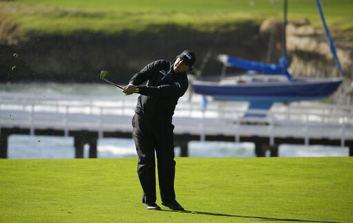 (AP Photo/Eric Risberg). Phil Mickelson follows his approach shot from the fourth fairway of the Pebble Beach Golf Links during the final round of the AT&T Pebble Beach Pro-Am golf tournament Sunday, Feb. 10, 2019, in Pebble Beach, Calif.