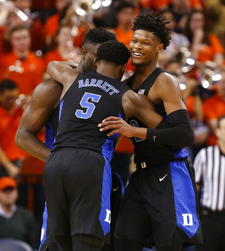 (Mark Gormus/Richmond Times-Dispatch via AP). Duke's Zion Williamson, left, RJ Barrett (5) and Cam Reddish celebrate the team's 81-71 victory over Virginia during an NCAA college basketball game in Charlottesville, Va., Saturday, Feb. 9, 2019.