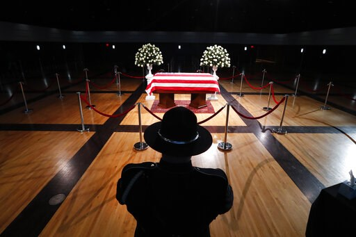 (AP Photo/Paul Sancya). A police officer stands guard stands guard at the casket of former Michigan Rep. John Dingell, lying in repose in Dearborn, Mich., Monday, Feb. 11, 2019. Dingell, the longest-serving member of Congress in American history, was f...