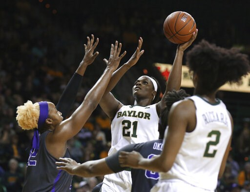 (AP Photo/Rod Aydelotte). Baylor center Kalani Brown, right, scores over TCU center Jordan Moore, left, in the second half of an NCAA college basketball game, Saturday, Feb. 9, 2019, in Waco, Texas. Baylor won 89-71.
