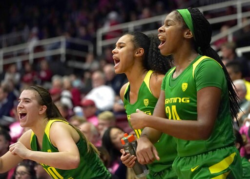 (AP Photo/Tony Avelar). Oregon's Sabrina Ionescu, left, Satou Sabally, center, and Ruthy Hebard celebrate in the last minute against Stanford during the second half of an NCAA college basketball game Sunday, Feb. 10, 2019, in Stanford, Calif.