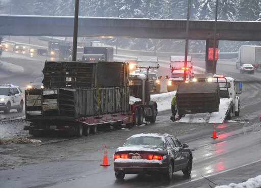 (Steve Bloom/The Olympian via AP). A semi-trailer hauling live chickens crashed on Interstate 5 near Olympia early Monday, Feb. 11, 2019, blocking several lanes in both directions. Schools closed across Washington state and the Legislature cancelled al...