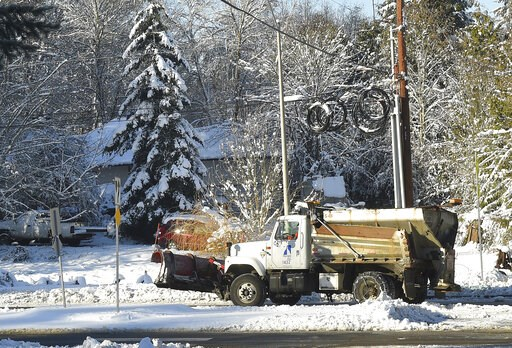 (Steve Bloom/The Olympian via AP). A City of Olympia sanding truck makes it way up a street on Sunday, Feb. 10, 2019, in Olympia, Wash. Pacific Northwest residents who are more accustomed to rain than snow are digging out from a winter storm and bracin...