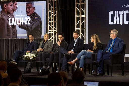 """(Photo by Willy Sanjuan/Invision/AP). Grant Heslov, from left, George Clooney, Christopher Abbott, Kyle Chandler, Ellen Kuras and Luke Davies participate in the """"Catch-22"""" panel during the Hulu presentation at the Television Critics Association Winter ..."""