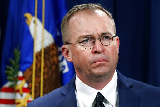 (AP Photo/Jacquelyn Martin, File). FILE- In this July 11, 2018, file photo Mick Mulvaney, acting director of the Consumer Financial Protection Bureau (CFPB), and Director of the Office of Management, listens during a news conference at the Department o...
