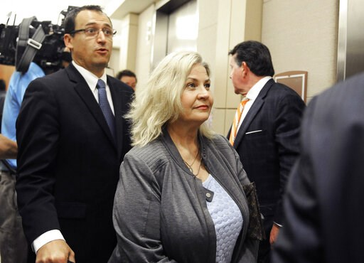 (AP Photo/Pat Sullivan, File). FILE - In this April 29, 2016, file photo, Sandra Merritt is surrounded by her attorneys as she leaves a courtroom after a hearing in Houston. Planned Parenthood has made an unusual legal demand to join California's crimi...