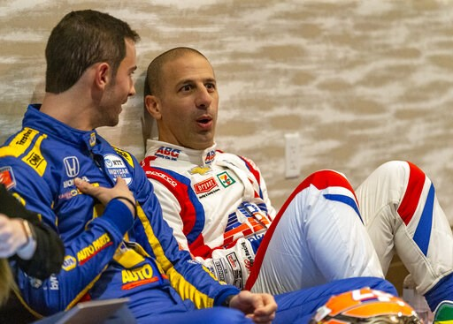 (AP Photo/Stephen Spillman). IndyCar driver Alexander Rossi, left, speaks with fellow driver Tony Kanaan between interviews during IndyCar auto racing media day, Monday, Feb. 11, 2019, in Austin, Texas.