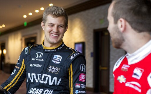 (AP Photo/Stephen Spillman). IndyCar driver Marcus Ericsson, of Sweden, speaks with fellow driver Ed Jones during IndyCar auto racing media day, Monday, Feb. 11, 2019, in Austin, Texas.