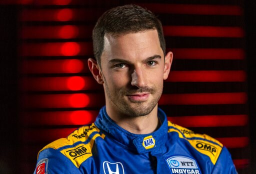 (AP Photo/Stephen Spillman). IndyCar driver Alexander Rossi is interviewed during IndyCar auto racing media day, Monday, Feb. 11, 2019, in Austin, Texas.