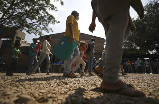 "(AP Photo/Fernando Vergara). Venezuelan migrants arrive at the ""Divina Providencia"" migrant shelter to receive a free lunch in La Parada, near Cucuta, on the border with Venezuela, Colombia, Monday, Feb. 11, 2019. Millions of Venezuelans have migrated,..."