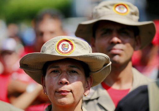 (AP Photo/Fernando Llano). Members of Venezuela's Bolivarian Militia listen to Diosdado Cabello, president of the Constitutional Assembly, during a rally in Urena, Venezuela, Monday, Feb. 11, 2019. Nearly three weeks after the Trump administration back...
