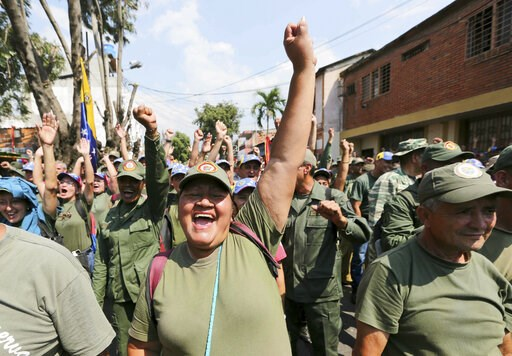(AP Photo/Fernando Llano). Members of Venezuela's Bolivarian Militia cheer for Diosdado Cabello, president of the Constitutional Assembly during a rally in Urena, Venezuela, Monday, Feb. 11, 2019.  Nearly three weeks after the Trump administration back...