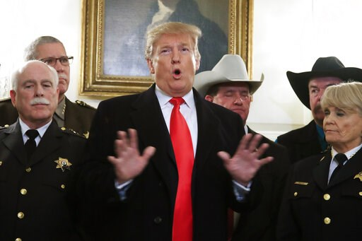 (AP Photo/Manuel Balce Ceneta). President Donald Trump speaks during a meeting with a group of sheriffs from around the country before leaving the White House in Washington, Monday, Feb. 11, 2019, for a trip to El Paso, Texas.