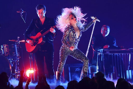 "(Photo by Matt Sayles/Invision/AP). Lady Gaga, right, and Mark Ronson perform ""Shallow"" at the 61st annual Grammy Awards on Sunday, Feb. 10, 2019, in Los Angeles."