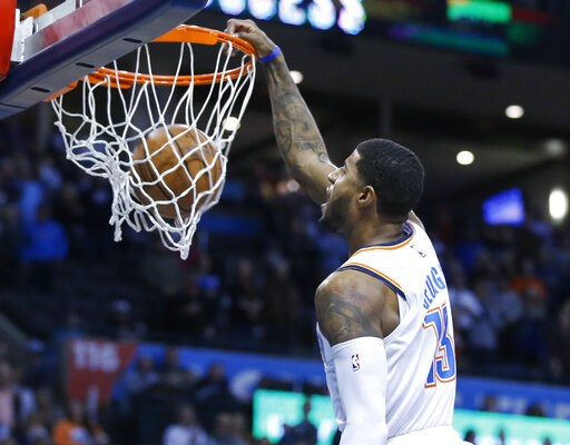 (AP Photo/Sue Ogrocki). Oklahoma City Thunder forward Paul George (13) dunks in the first half of an NBA basketball game against the Portland Trail Blazers in Oklahoma City, Monday, Feb. 11, 2019.