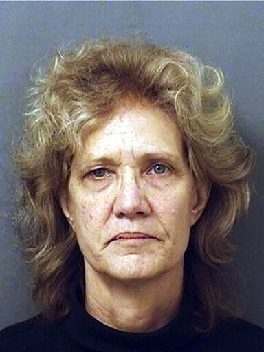 (Palm Beach County Detention Center/Palm Beach County Sheriff's Office via AP). This undated photo provided by the Palm Beach County Sheriff's Office shows Amy Elizabeth Fleming, 60, of Dania, Fla. Fleming, who moved to Florida from the Las Vegas area ...