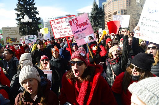(Helen H. Richardson/The Denver Post via AP). Lori Gates, center, a 3rd grade teacher from Park Hill elementary school, shouts with other teachers during a strike rally on the west steps of the state Capitol on the first day of the Denver Public School...