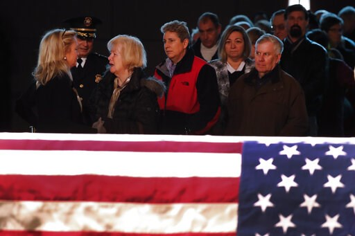(AP Photo/Paul Sancya). Rep. Debbie Dingell, D-Mich., left, greets the public at the casket of her husband, former Rep. John Dingell, lying in repose in Dearborn, Mich., Monday, Feb. 11, 2019. John Dingell, the longest-serving member of Congress in Ame...