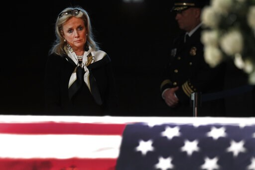 (AP Photo/Paul Sancya). Rep. Debbie Dingell, D-Mich., stands at the casket of her husband and former Rep. John Dingell, lying in repose in Dearborn, Mich., Monday, Feb. 11, 2019. John Dingell, the longest-serving member of Congress in American history,...
