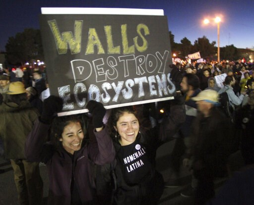 (AP Photo/Rudy Gutierrez). Isa Casillas, left, and Janelle Hernandez, of Las Cruces, N.M., take part in a march and rally outside the El Paso County Coliseum, where President Trump was scheduled to speak in a rally, in El Paso, Texas, Monday, Feb. 11, ...