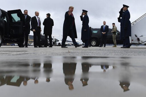 (AP Photo/Susan Walsh). President Donald Trump waves as he arrives to board Air Force One at Andrews Air Force Base in Md., Monday, Feb. 11, 2019. Trump is heading to El Paso, Texas, to try and turn the debate over a wall at the U.S.-Mexico border back...