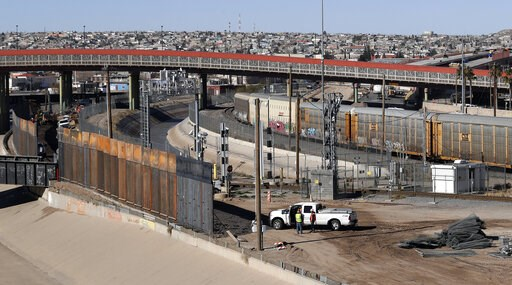 (AP Photo/Eric Gay). In this Tuesday, Jan. 22, 2019, photo, a new barrier is built along the Texas-Mexico border near downtown El Paso. Such barriers have been a part of El Paso for decades and are currently being expanded, even as the fight over Presi...