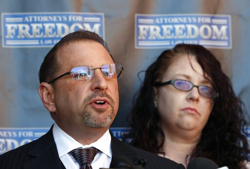 (AP Photo/Matt York). Attorney Marc J. Victor speaks to the media concerning his client, Johnny Wheatcroft, Monday, Feb. 11, 2019, in Chandler, Ariz. as Wheatcroft's wife, Anya Chapman, right, listens. Victor has filed a lawsuit on behalf of Wheatcroft...