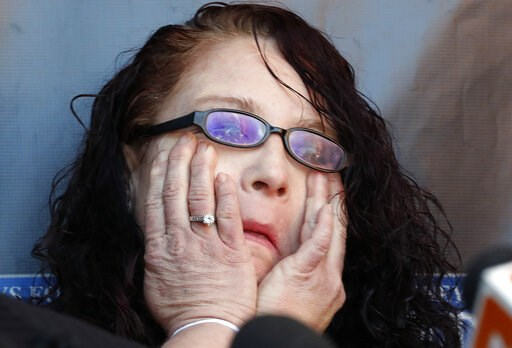 (AP Photo/Matt York). Anya Chapman wipes away tears as attorney Marc J. Victor speaks to the media concerning Chapman's husband, Johnny Wheatcroft, Monday, Feb. 11, 2019, in Chandler, Ariz. Victor has filed a lawsuit on behalf of Wheatcroft claiming th...