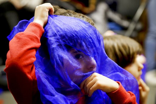 (AP Photo/Chris Carlson). In this Jan. 23, 2019, photo, Samyar Najafi, 4, plays with a scarf during Persian story time at Irvine public library in Irvine, Calif. It's been four decades since the Iranian revolution overthrew the ruling shah, prompting t...