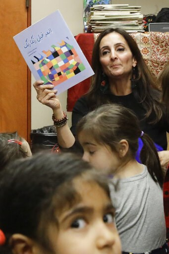 (AP Photo/Chris Carlson). In this Jan. 23, 2019, photo, Bahareh Hedyahe leads Persian story time at Irvine public library in Irvine, Calif. It's been four decades since the Iranian revolution overthrew the ruling shah, prompting tens of thousands of Ir...