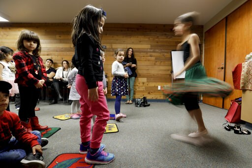 (AP Photo/Chris Carlson). In this Wednesday, Jan. 23, 2019 photo, children dance during Persian story time at Irvine public library in Irvine, Calif. It's been four decades since the Iranian revolution overthrew the ruling shah, prompting tens of thous...