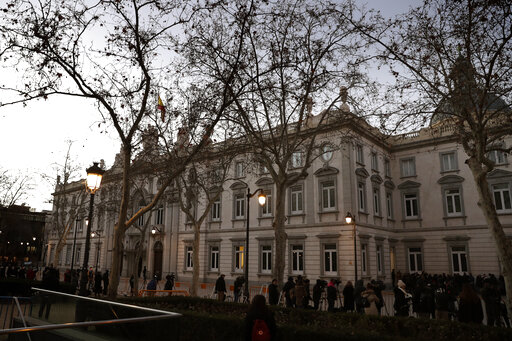 (AP Photo/Manu Fernandez). Journalists wait outside the Spanish Supreme Court in Madrid, Tuesday, Feb. 12, 2019. Spain is bracing for the nation's most sensitive trial in four decades of democracy this week, with a dozen Catalan separatists facing char...