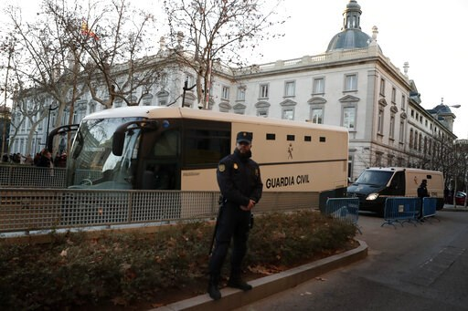 (AP Photo/Manu Fernandez). A bus belonging to Spain's Civil Guard allegedly carrying Catalonian politicians and activists, arrives at the Spanish Supreme Court in Madrid, Tuesday, Feb. 12, 2019. Spain is bracing for the nation's most sensitive trial in...