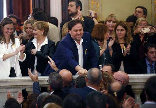 (AP Photo/Manu Fernandez, File). FILE - In this Friday, Oct. 27, 2017 file photo, Catalan Vice President Oriol Junqueras, center, is greeted after a vote on independence in the Catalan parliament in Barcelona, Spain. Spain's Supreme Court is bracing to...