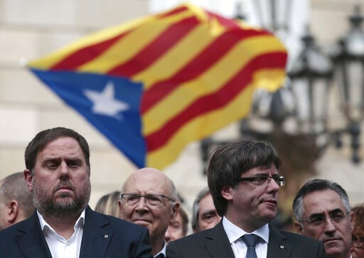 (AP Photo/Manu Fernandez, File). FILE - In this Monday, Oct. 2, 2017 file photo, Catalan regional Vice-President, Oriol Junqueras, left, and Catalan President, Carles Puigdemont, attend a protest called by pro-independence supporters outside the Palau ...