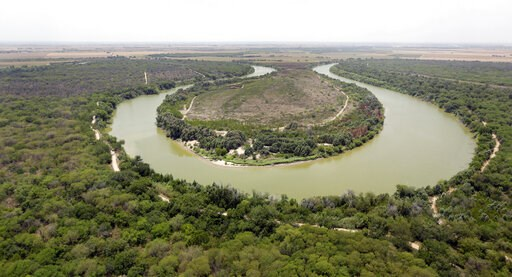(AP Photo/Eric Gay, Pool, File). FILE - In this July 24, 2014, file photo, a bend in the Rio Grand is viewed from a Texas Department of Public Safety helicopter on patrol over in Mission, Texas. The U.S. government is preparing to begin construction of...