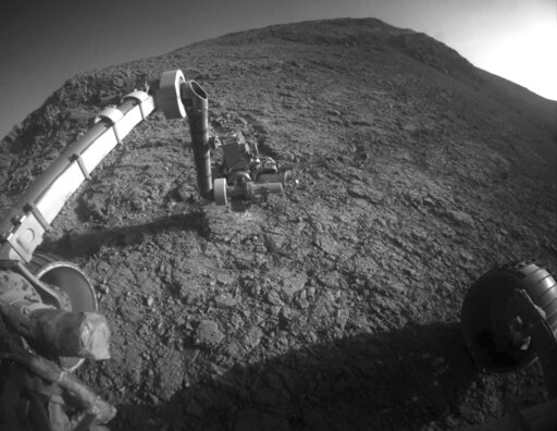 "(NASA/JPL-Caltech via AP). This Jan. 5, 2016 photo made available by NASA shows the tool turret at the end of the the Opportunity rover's robotic arm on the southern side of ""Marathon Valley,"" which goes through the western rim of Endeavour Crater."