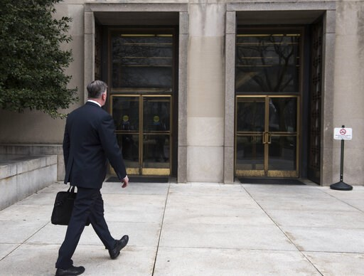(AP Photo/Kevin Wolf). Kevin Downing, defense attorney for Paul Manafort, walks to the entrance of federal court on Wednesday, Feb. 13, 2019 in Washington.